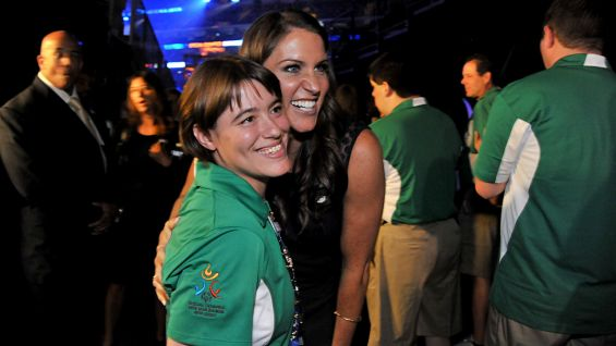 WWE Chief Brand Officer Stephanie McMahon poses with a Special Olympics Connecticut athlete at the 2014 Special Olympics USA Games Opening Ceremonies.