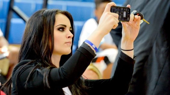 NXT Women's Champion Paige takes a photo of the crowd to send out to her fans on social media.