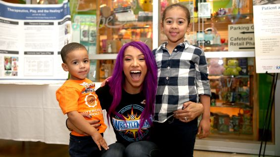 Sasha Banks brings smiles to children's faces at Orlando's Arnold Palmer Hospital for Children.