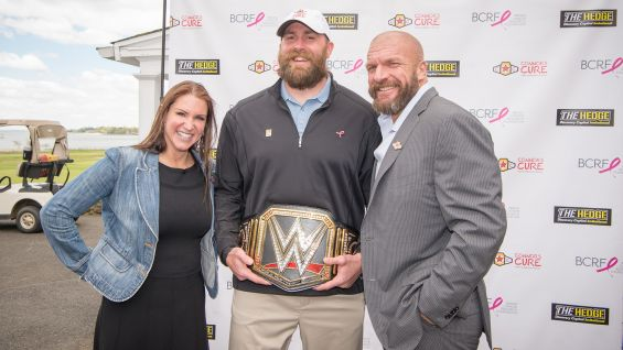 Stephanie McMahon and Triple H pose with former Pittsburgh Steeler great Brett Keisel at the Hedge Invitational.