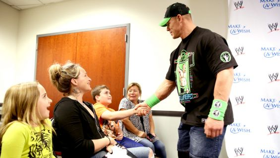 Mark and his family meet Cena before Raw at Los Angeles' STAPLES Center.