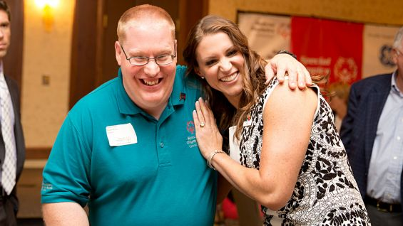 WWE Chief Brand Officer Stephanie McMahon poses with a Special Olympics Connecticut athlete at the Team Connecticut send-off dinner.