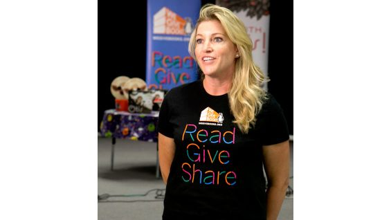 Jennifer Malchiodi of We Give Books kicks off the event.