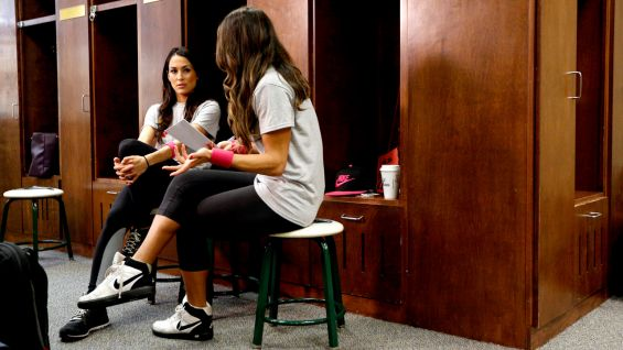 Nikki and Brie Bella talk strategy before the game.