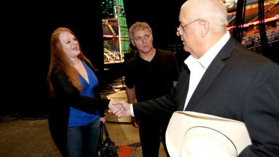WWE Hall of Famer Dusty Rhodes says hello to Superstars for Sandy Relief Auction winners Warren Kostuch and Shana Kinnaman before Raw at Amway Arena in Orlando, Fla.
