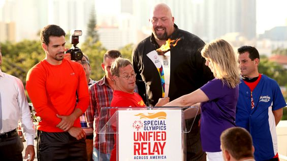 Special Olympics Florida CEO Sherry Wheelock officially lights the Flame of Hope and passes it to Special Olympics Athlete and Unified Relay Co-Captain Zach Commander.