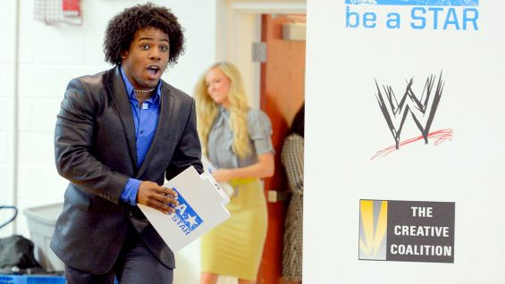 Xavier Woods, Summer Rae and Darren Young kick off the rally.