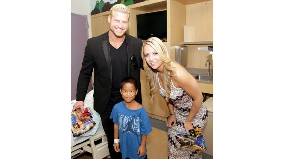 Dolph Ziggler and Emma make a youngster smile.