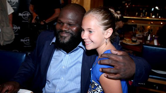 Mark Henry brings smiles to the faces of the honorees and their families.