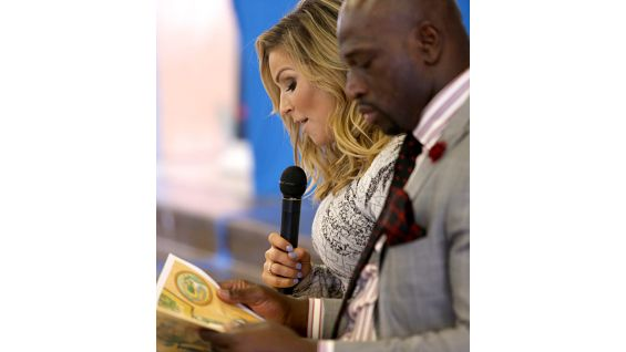 """Natalya and O'Neil read """"Not Your Typical Dragon"""" to the students."""