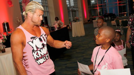 "WWE and Komen are expanding their joint ""Rise Above Cancer"" campaign to include all WWE Superstars and Divas wearing pink ring gear, such as the shirt Dolph Ziggler is wearing."