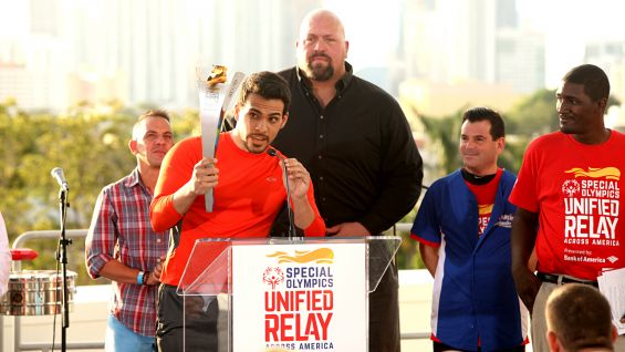 Geovanni Gopradi, actor and Special Olympics Goodwill Ambassador for the 2015 World Games, holds the Flame of Hope.