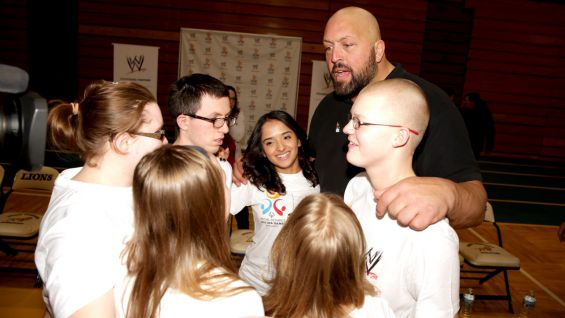 Big Show gives the athletes a pep talk before the basketball game.