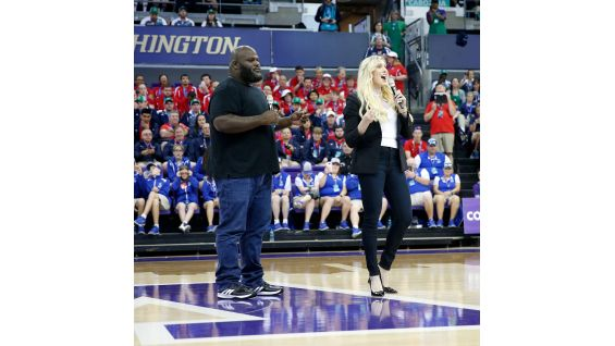 Charlotte Flair and Mark Henry give some encouraging words at the Parade of Athletes.
