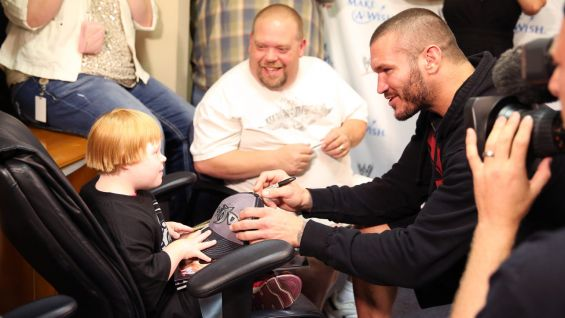 Orton signs autographs for the 6-year-old.