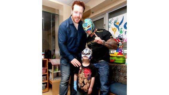 Sheamus and Mysterio bring smiles to the kids' faces at the hospital.