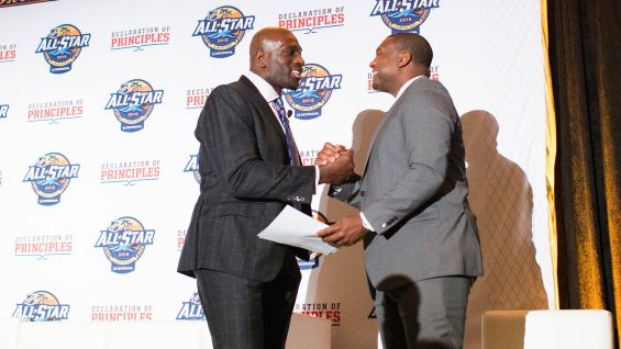 O'Neil was one of the distinguished panelists. He greets Kevin Weekes, the emcee for the event.