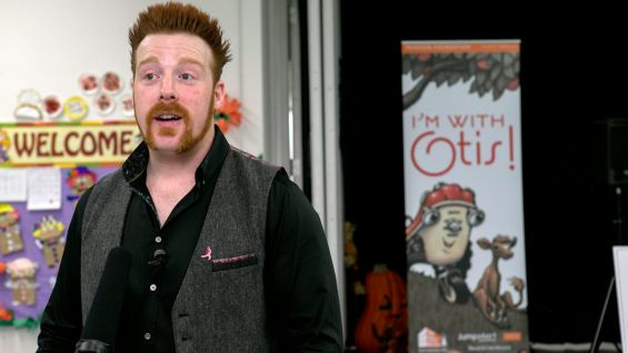 "Sheamus reads ""Otis"" to more than 160 elementary schoolers."