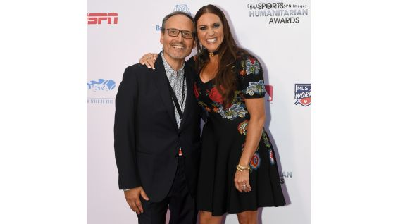 Stephanie poses on the red carpet with ESPN's Vice President of Corporate Citizenship, Kevin Martinez.