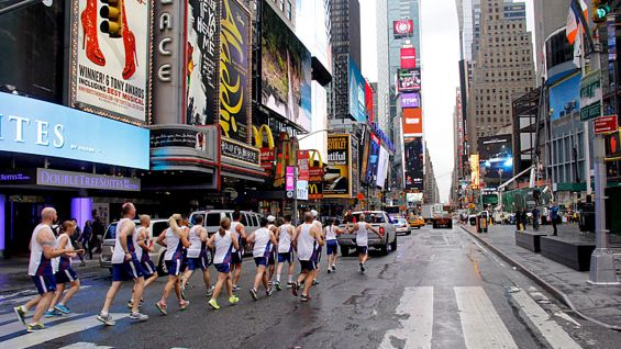 The Flame of Hope is carried through the busy streets of Times Square.