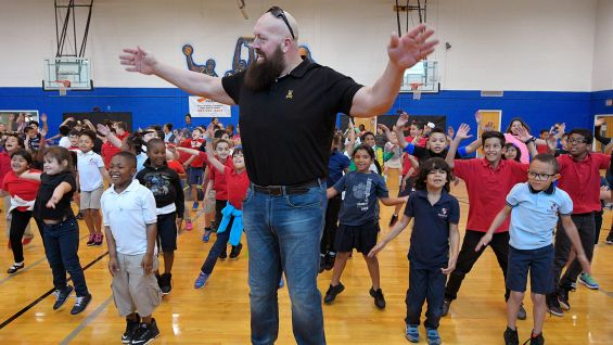 Big Show leads the charge in a group exercise.