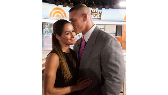 "Cena shares a moment with girlfriend, Divas Champion Nikki Bella, backstage at ""Today."""