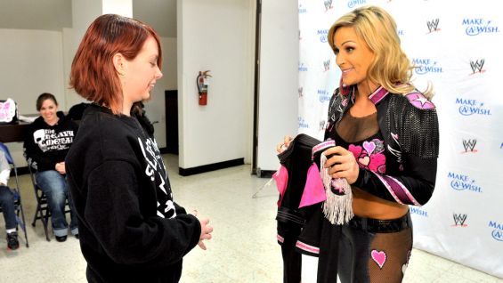 Natalya gives her ring jacket from WrestleMania XXV to Alexis.