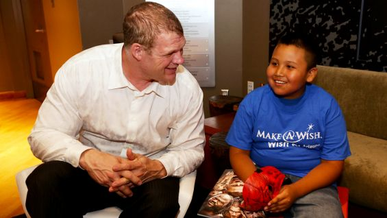 Corporate Kane takes a break from WWE business to meet the youngster.