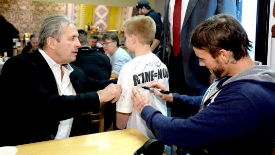 "Will, 8, gets autographs from WWE Hall of Famer Bret ""Hit Man"" Hart and CM Punk."