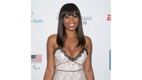 ESPN's Cari Champion poses for pictures before the event.