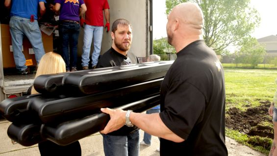 Curtis Axel and Ryback help with the heavy lifting in day one of the playground build preparation.