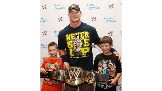 The WWE Champion poses with Nick and his brother.
