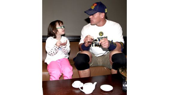 The Champ enjoys a tea party with the young Circle of Champions honoree.