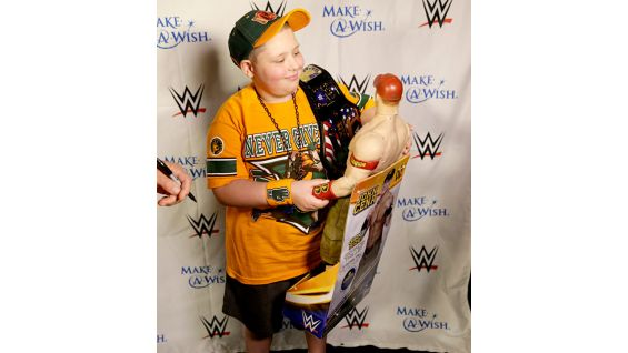 Cena presents several toys to Rocco.