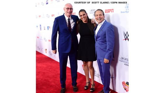Stephanie poses with John Skipper, ESPN President, and Kevin Martinez, ESPN Vice President of Corporate Outreach.