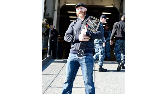 Sheamus brings the WWE World Heavyweight Championship on board the USS New York.
