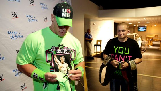 Cena signs autographs for one of his biggest fans.