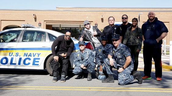 The Usos, Naomi, Ryback and Dean Ambrose pose with the U.S. Navy police.