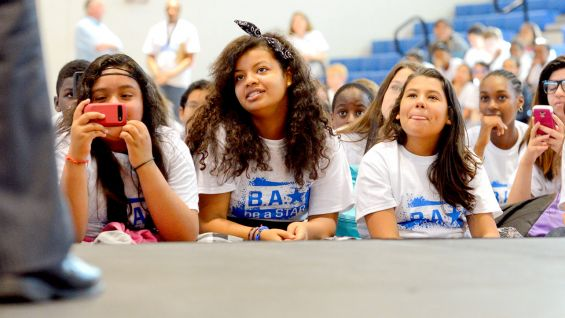 The sixth-, seventh- and eighth-graders listen to the Superstars' personal stories at the anti-bullying rally.