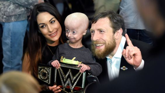 Brie Bella and husband Daniel Bryan meet many of the children at the hospital.