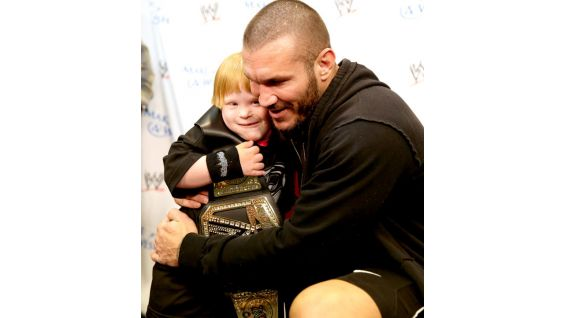Orton gives a hug to the Circle of Champions honoree.