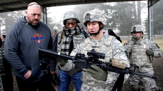 Big Show and Booker T learn about the weapons used by the U.S. Military.