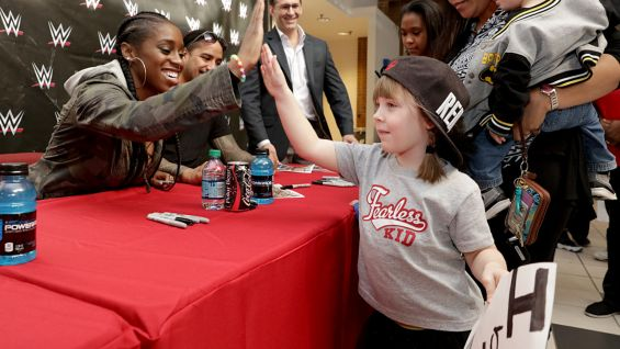 "Naomi is more than happy to dish out high-fives with a future ""Total Diva."""