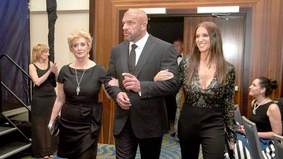 Linda and Stephanie McMahon accompany Levesque.