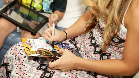 Emma signs an autograph for a young fan at CHLA.