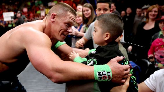 John Cena greets Amir during Raw in Denver's Pepsi Center.