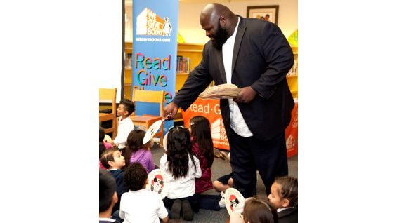 "The Superstars pass out copies of the children's book ""Otis"" on behalf of WWE, Pearson Foundation and We Give Books."