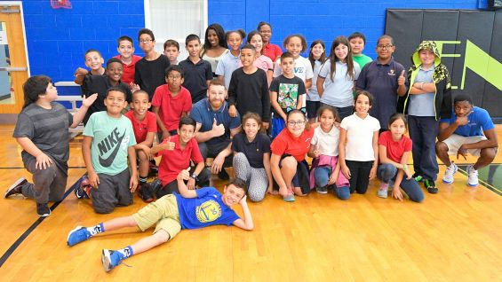 Sami Zayn and Ember Moon bring smiles to the Englewood Neighborhood Center in Orlando.