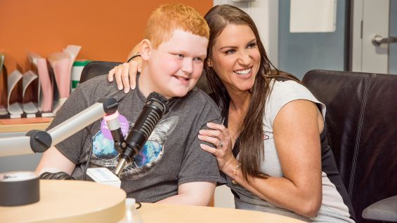 Stephanie and the three Raw Superstars meet children at the hospital.