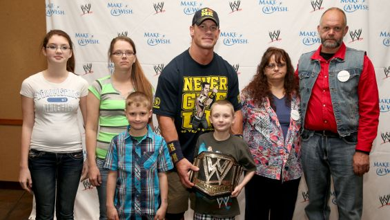 "Jacob, aka ""The Eliminator,"" and his family pose with The Champ."